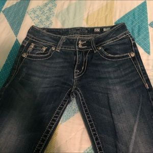 Size 27 Miss Me boot cut, low waisted jeans